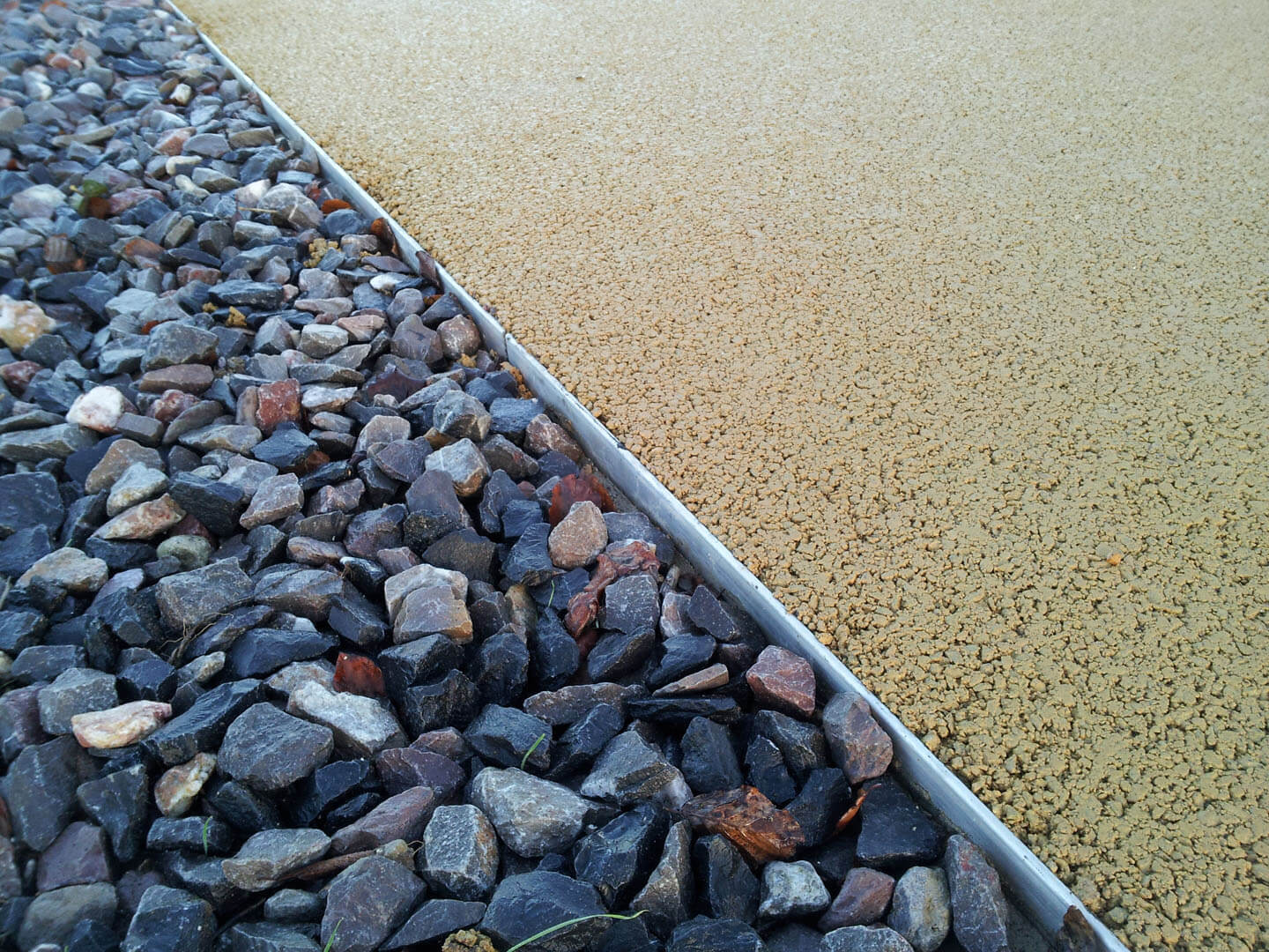 Gravel driveway with resin driveway