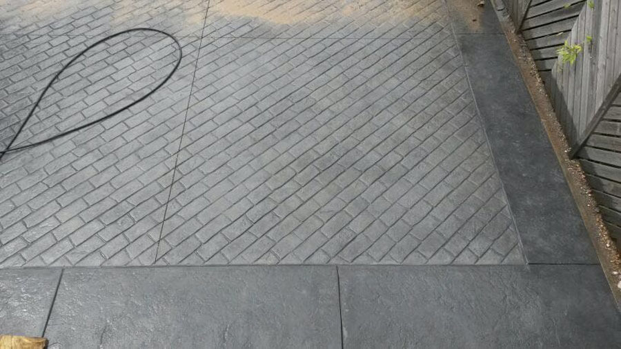 Pattern imprinted concrete driveway and flagstone